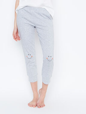 Pantalon imprimé smiley gris.