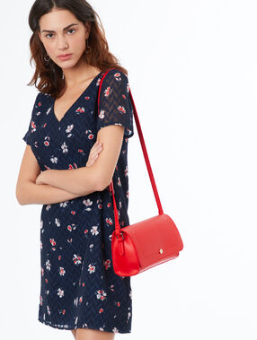 Sac besace rouge.