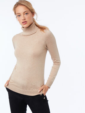 Pull col roulé beige.