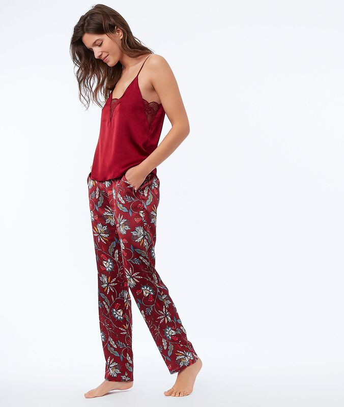 Pantalon fleuri en satin rouge.