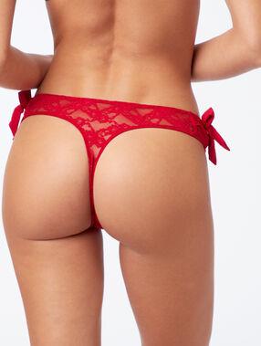 Tanga en dentelle et petits nœuds rouge.