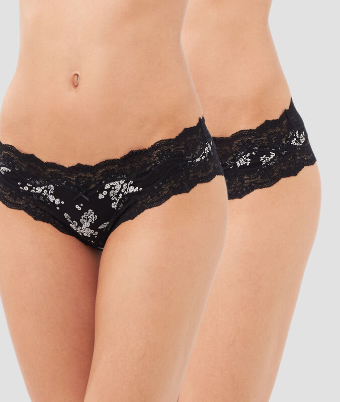 Lot de 2 shortys à bords dentelle noir/blanc.