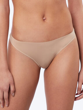 String micro finition thermocollée beige/ peau.