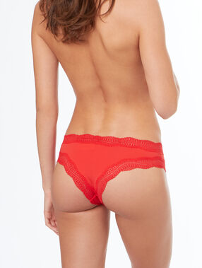 Tanga bords dentelle orange.