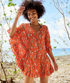 Tunique de plage à fleurs rouge.