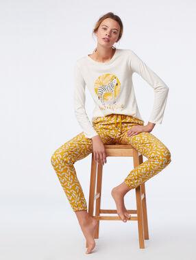 Pantalon imprimé feuillage ocre.