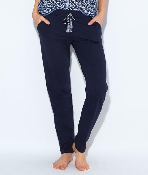 Pantalon, détail ceinture à pompons