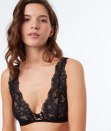 Brassière en dentelle décolletée, façon corset noir.