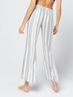 Pantalon rayé, noué à la taille ecru.