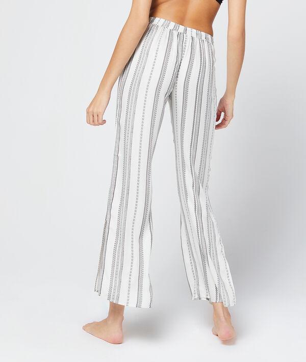 Pantalon rayé, noué à la taille