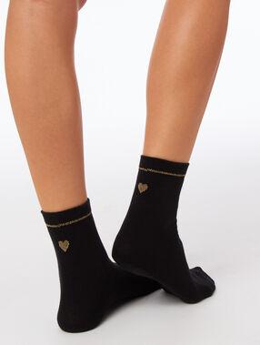 Chaussettes à fil métallisé noir.