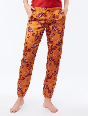 Pantalon satin resserré aux chevilles ocre.