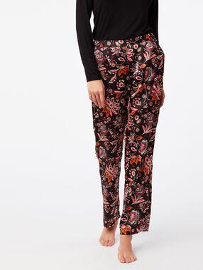 Pantalon large imprimé floral noir.