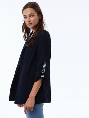 Veste avec bandes latérales bleu marine.