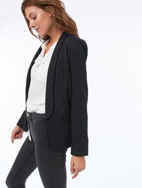 Veste de tailleur col châle noir.