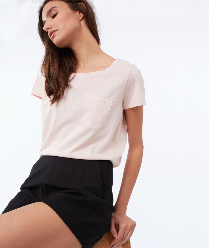 T-shirt col rond en coton rose pâle.