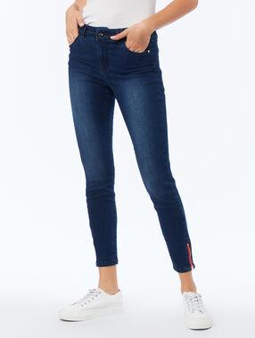 Jean skinny avec zip sur le côté bleu brut.