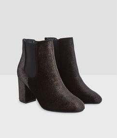 Boots à talons pailleté noir.