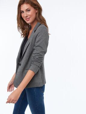 Veste de tailleur motifs chevrons gris et noir.