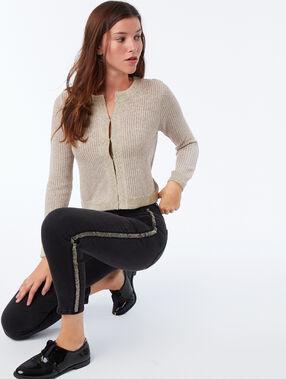 Veste courte à fil métallisé beige.