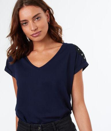 T-shirt avec broderie bleu marine.