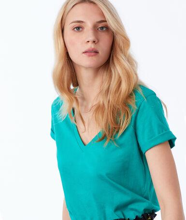 T-shirt col v en coton vert menthe.