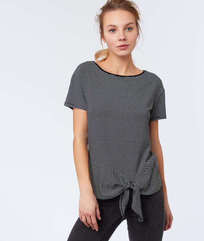 T-shirt à rayures noir.