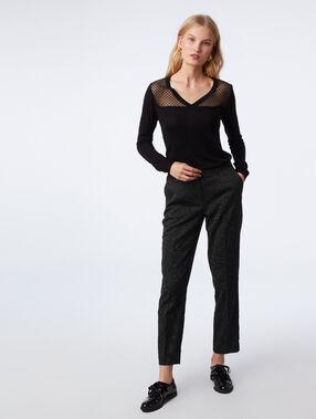 Pantalon cigarette à motifs jacquard noir.