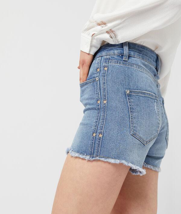 Short en jean à bords frangés
