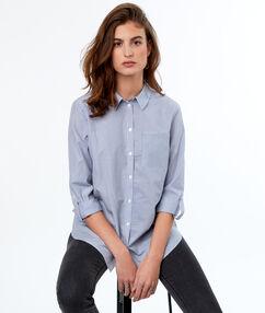 Chemise à rayures bleu.