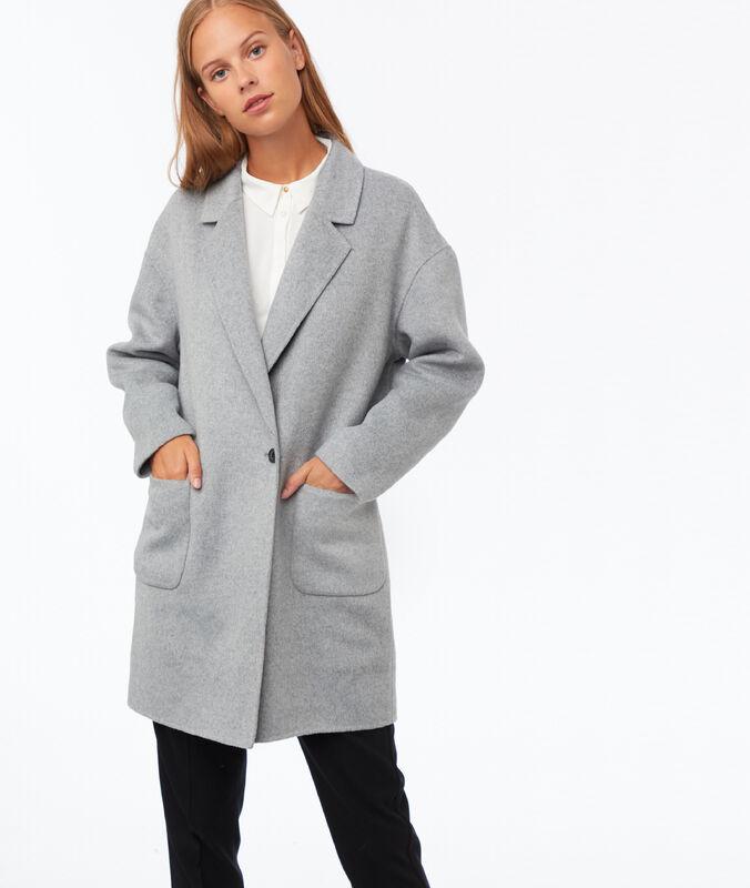 Manteau oversize gris clair chiné.