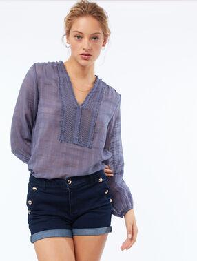 Short avec poches boutonnées bleu foncé délavé.