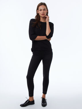 Jean skinny perlé noir.