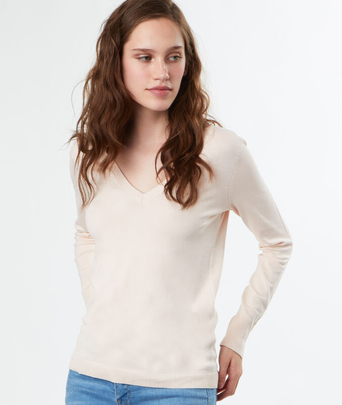 Pull tricot col v rose pale.