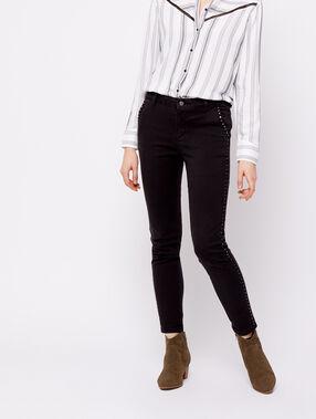 Pantalon slim à clous noir.