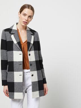 Manteau droit à gros carreaux noir.