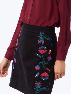Jupe évasée avec fleurs brodées noir.