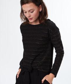 Pull en coton majoritaire noir.