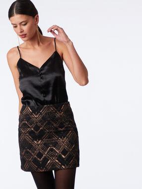 Jupe à motifs et fils métallisés noir.