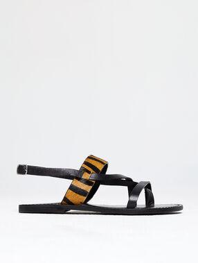 Sandales plates à imprimé animalier noir.