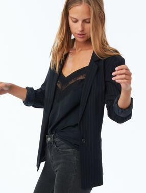 Veste de tailleur à rayures bleu marine.